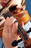 Boy (8-9) playing violin, close up,, close-up