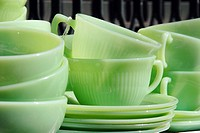 1950's Vintage Green Glass Dishes displayed at an outdoor flea market (thumbnail)