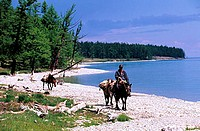 Mongolia, Khovsgol Province, rider along Khovsgol Lake in the Khovsgol National Park