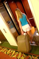 Female getting on elevator
