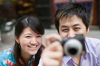 Young couple taking pictures with a digital camera