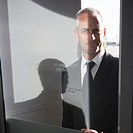 Businessman Behind Glass Door