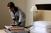 Businesswoman packing a suitcase
