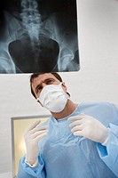 Surgeon Looking at X-ray