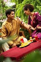 Couple Enjoying a Meal in a Garden