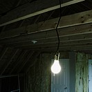 Bare Light Bulb in Unfinished Room