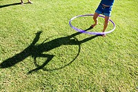 Shadow of Girl playing with toy hoop