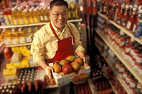 Grocer in His Store