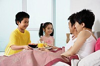 Children Bringing Parents Breakfast in Bed