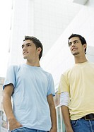 Two teen boys standing, looking out of frame