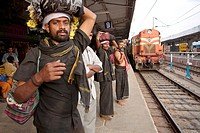 An ayappa pilgrim waiting for the train on the platform in Tirupati. He is heading toward Sabarimala ( kerala) for the Ayappa pilgrimage, a yearly eve...