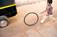 a kid playing in the streets of Badami, a beautiful historical town of Karnataka. He was chasing a rickshaw