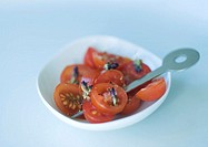 Bowl of sliced tomatoes and cocktail stick