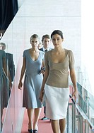 Group of businesspeople walking toward camera