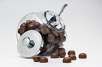 Chocolate candy in glass container with metal lid off
