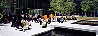 Group Of People Sitting Outside A Museum, Museum Of Modern Art, NYC, New York City, New York State, USA