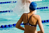 Rear view of a woman in a swimming pool