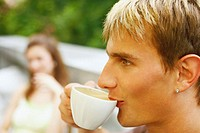 Close-up of a young man having a cup of tea
