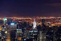 Aerial view of a city lit up at night, New York City, New York State, USA