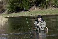 Mature man fishing in the river