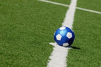 Close-up of a soccer ball placed on a yard line
