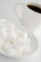 Close-up of sugar cubes in a plate