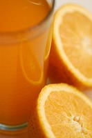Close-up of orange juice with two orange slices