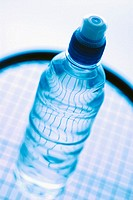 Close-up of a water bottle on a tennis racket