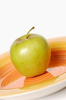 Close-up of an apple on a tray