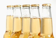Close-up of bottles of apple juice (thumbnail)