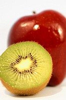 Close-up of half a kiwi and an apple