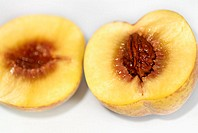 Close-up of a peach cut in half