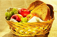 Close-up of fruit and brown bread in a basket