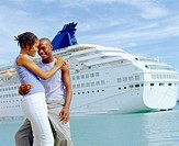 Close-up of a young couple embracing each other in front of a cruise ship, Bermuda