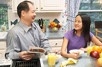 Close-up of a father and his daughter in the kitchen