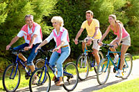 Parents with adult children riding bicycles