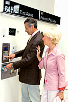Senior couple getting ticket out of machine