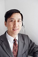 Portrait of a customer service representative wearing a headset smiling