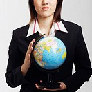 Portrait of a businesswoman holding a globe