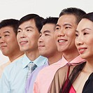 Close-up of business executives smiling and looking away