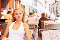 Portrait of a young woman sitting in a restaurant