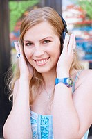 Portrait of a young woman wearing headphones