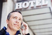 Low angle view of a mature man talking on a mobile phone