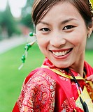 Portrait of a young woman in the traditional clothing smiling