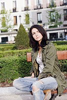 Mid adult woman sitting on a park bench