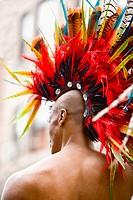 Rear view of a gay man wearing a colorful headdress