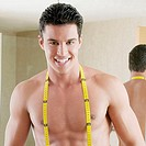 Portrait of a young man with a tape measure around his neck (thumbnail)