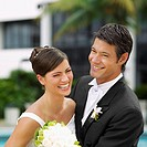Close-up of a newlywed couple smiling (thumbnail)