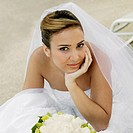 Portrait of a bride sitting with her hand on her chin