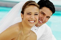 Portrait of a newlywed couple smiling